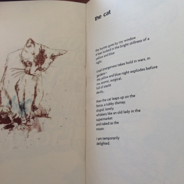 "Facing pages for ""The Cat"" poem"